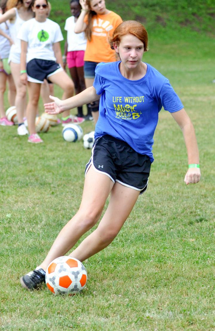girl-soccer-kick