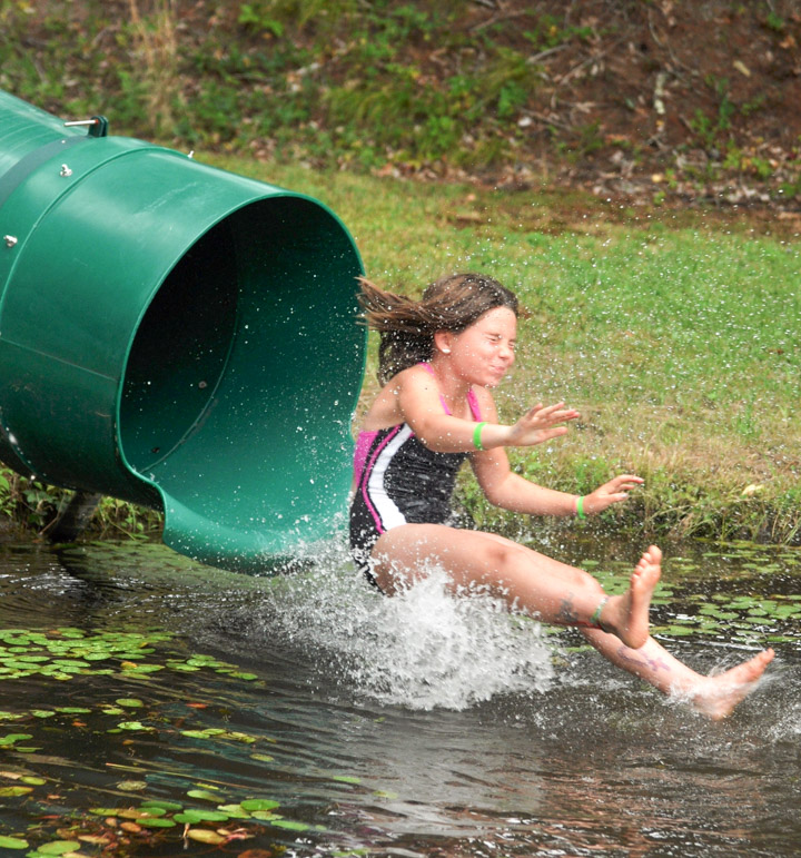 Fantastic Camp Girl Slides Down Inflated Slide