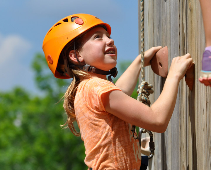 young-girl-climbing-wall